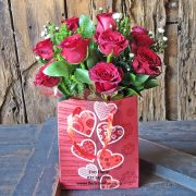 12 red roses in a gift bag