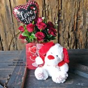 12 red roses, choc and balloon and dog