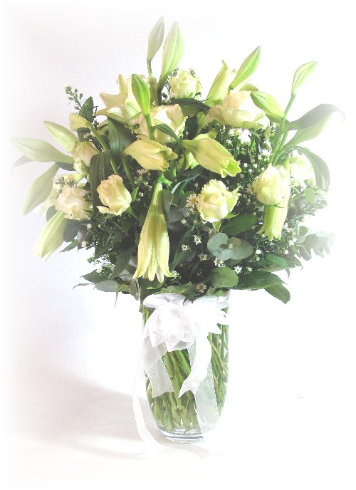 selection of white seasonal flowers in clear vase