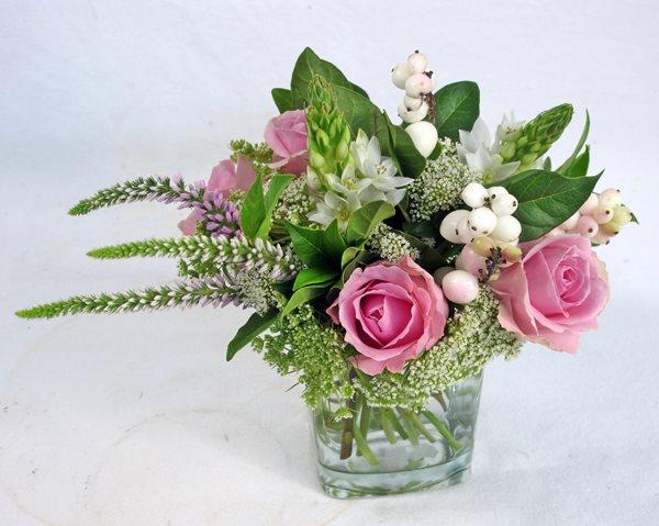 Mini glass vase of roses and filler