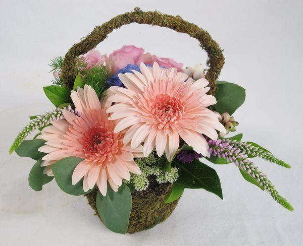 Mini moss basket of roses, gerbera and filler