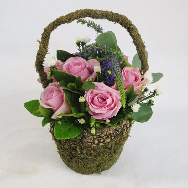 Mini moss basket of roses and filler