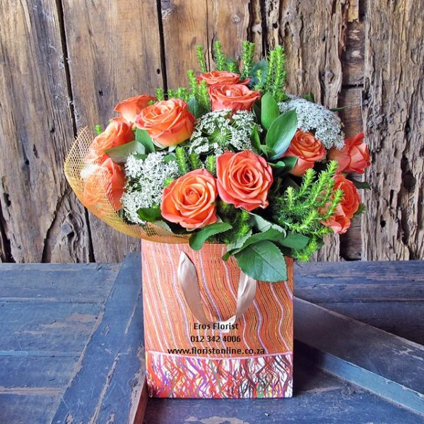12 roses in gift bag