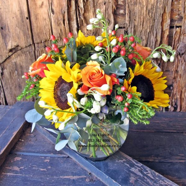 Sunflowers and roses in round vase