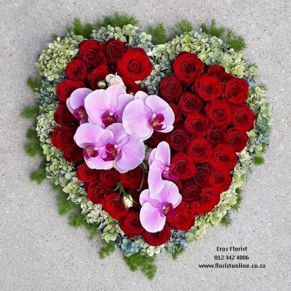 Heart shaped funeral tribute in fresh flowers
