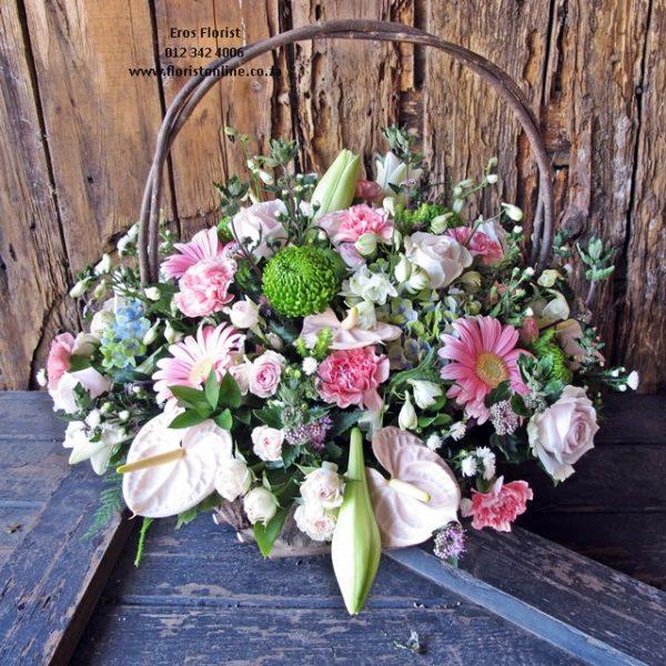 Pink seasonal flower basket by Eros Florist